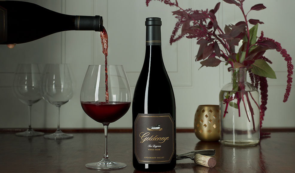 Pouring Goldeneye Ten Degrees Pinot Noir wine into a glass