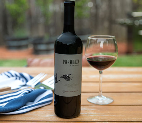 Paraduxx red wine with a glass of red wine outdoors