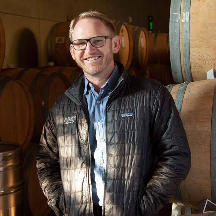 Winemaker Cardiff Scott-Robinson in Paraduxx barrel room