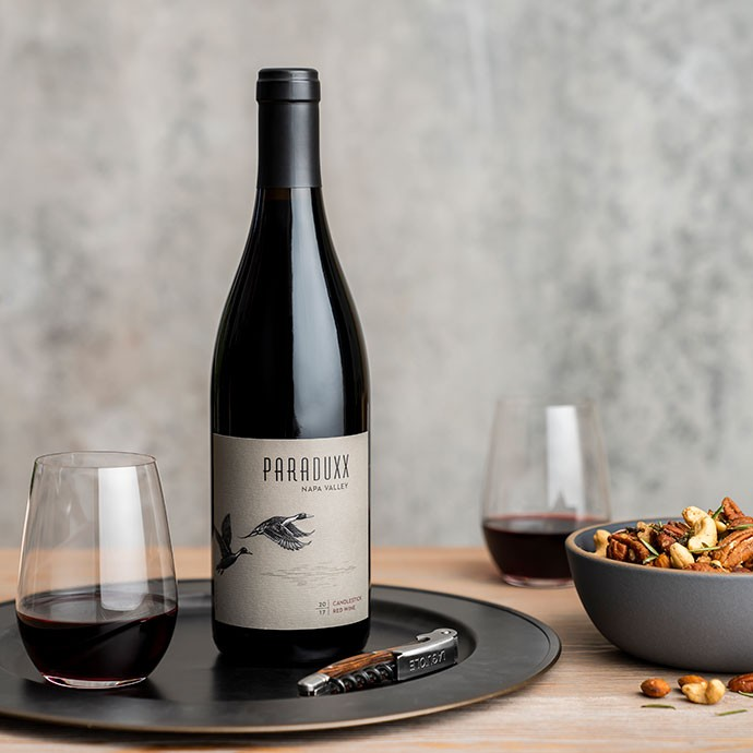 Paraduxx red blend wine with two glasses and roasted nuts