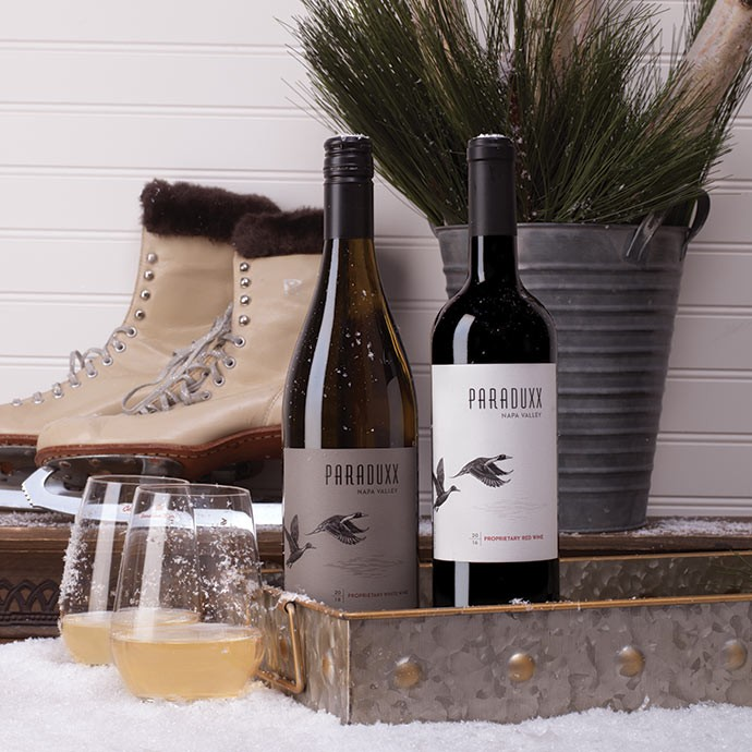Paraduxx Red and White Proprietary wines in the snow with ice skates