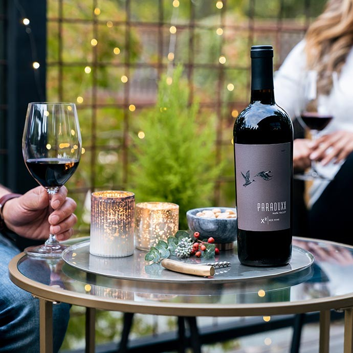 2017 Paraduxx X2 Napa Valley Red Wine on a table being enjoyed by a couple